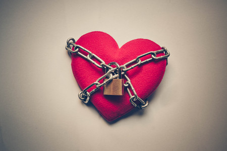 forbidden love: A heart tied with chains and locks
