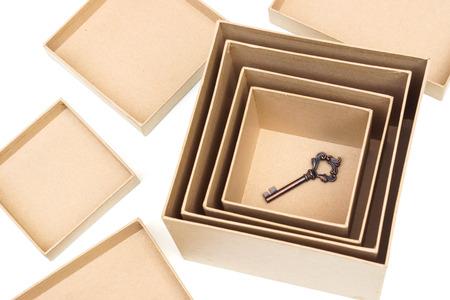decrypt: A key in boxes  Hidden secret concept