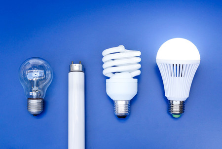 e27: Old and new generation of light bulbs - incandescent light bulb, fluorescent bulb, and LED bulb on blue background