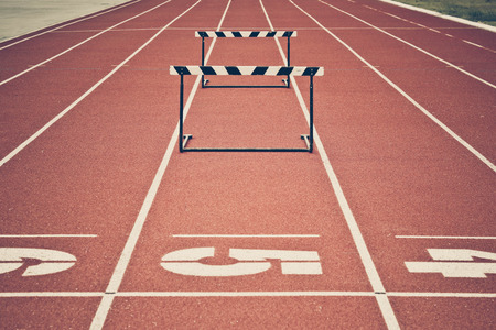 hurdle: Jump hurdle on running track