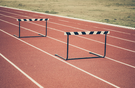 hurdle: Jump hurdle on running track vintage Stock Photo