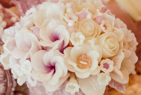 scented candle: Scented wax candle in beautiful flower shape