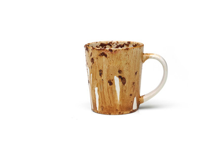 Dirty coffee cup due to putting a cup of coffee in a microwave oven Stock Photo