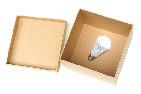switched: Opened brown paper box with switched on LED light bulb inside  New idea concept Stock Photo