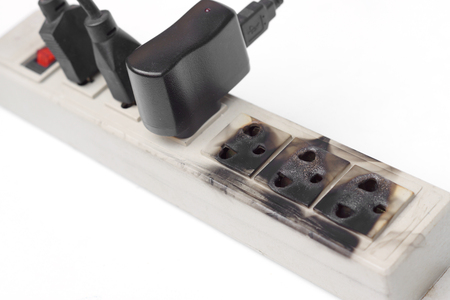 the protector: Surge protector caught on fire due to overheat Stock Photo