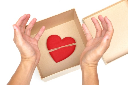 sulk: Hand open a paper box with a broken red heart inside  Ending relationship concept Stock Photo
