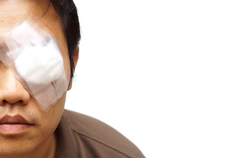 wounded: Medicine plaster patch on human injury wounded eye Stock Photo