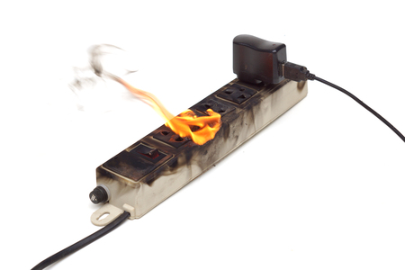 Surge protector caught on fire due to overheat Stock Photo