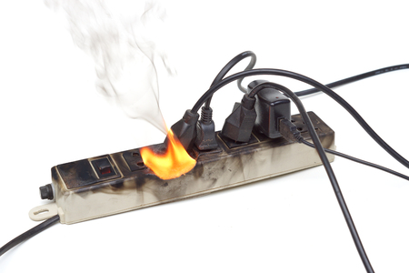 Surge protector caught on fire due to overheat Archivio Fotografico