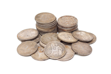 A pile of French Indo-China Silver 1 Piastre Trade Dollar 1907 isolated on white Stock Photo