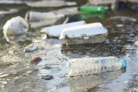 Water pollution - Plastic and foam garbage floating on the surface of the river - Environmental problem caused by human activity Archivio Fotografico
