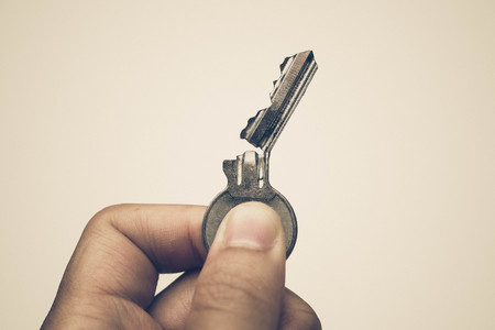 Closeup of hand holding a broken key isolated  Success and failure concept