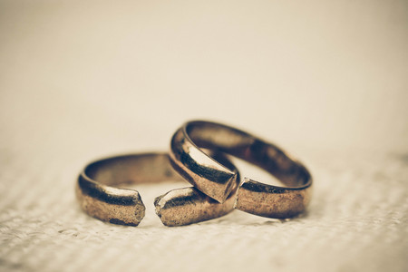 dissappointed: Two broken rings  Divorce concept