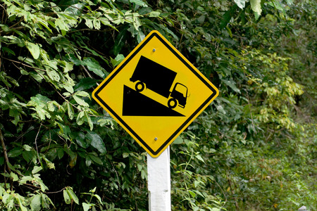 downgrade: Steep downhill road sign