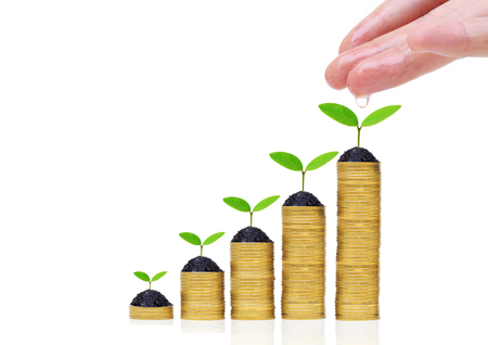 csr: Hand watering green plants growing on a pile of golden coins  Green business and investment  Business with environmental concern  business with csr