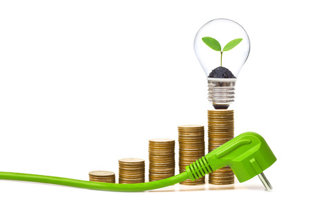 wall socket: A green electricity plug with stack of golden coins and a young plant in a lightbulb  Green energy creating wealth concept