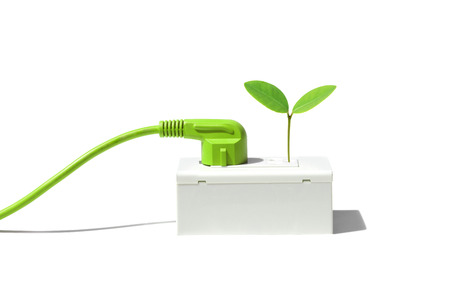 csr: Green plug with a young green plant  Green energy concept Stock Photo