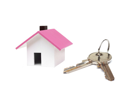 A small house and a key  Buying a house concept Stock Photo