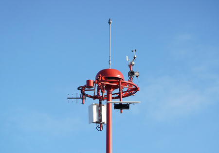 Weather measurement unit with blue sky background  Low Level Wind Shear Alert System : LLWAS Stock Photo