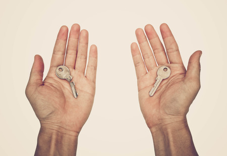 Hands holding a usable key and a broken key  Symbol of success and failure concept