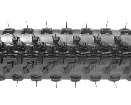 tread: Closeup of Mountain bike tire full of tread isolated Stock Photo