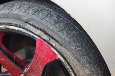 sidewall: Old tire of a car with break  Danger of using an old tire for driving concept