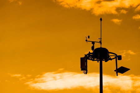 Silhouette of Weather measurement unit with blue sky background  Low Level Wind Shear Alert System : LLWAS