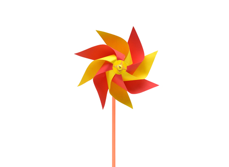 plaything: Toy windmill propeller set with multicolored blades isolated on white