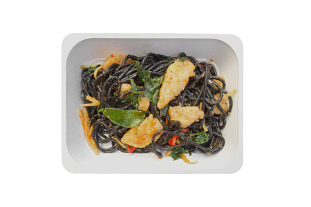 Black spaghetti with fried fish, basil leaves and chilli