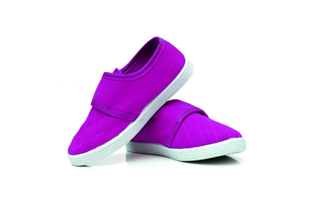 purple shoes: Purple slip on shoes isolated Stock Photo
