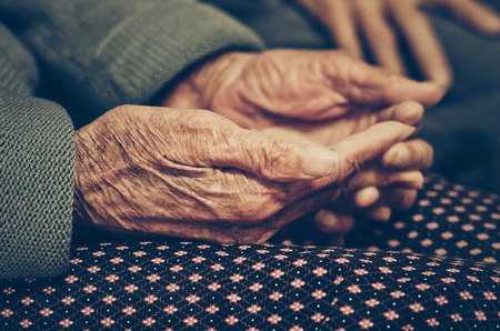 Old Asian female hands full of freckles and wrinkles at the age of more than 80 years old  Aging concept