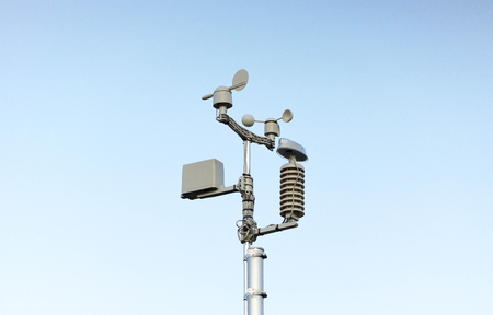 Weather station on blue sky background Stock Photo