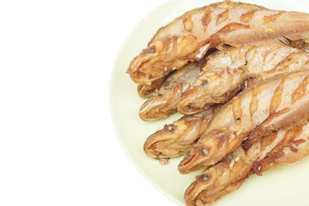 Fried Sheatfishes on dish isolated on white