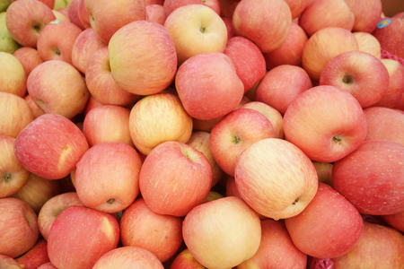 A pile of fuji apples