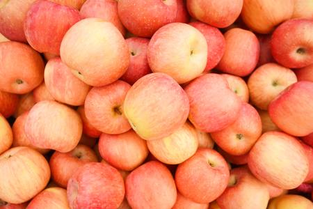 A pile of fuji apples