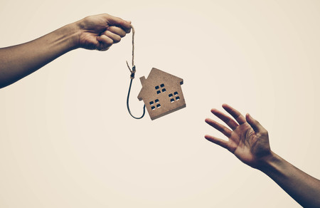 A house on a fish hook  Risks and negative sides of buying a house concept
