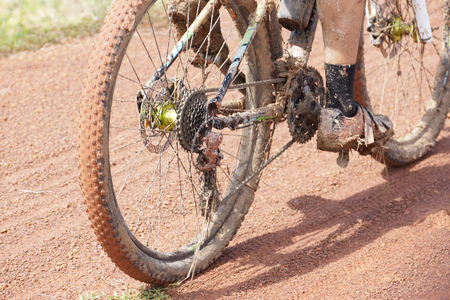 Mountain bike cyclist riding on a muddy road  Cycling in wet condition concept