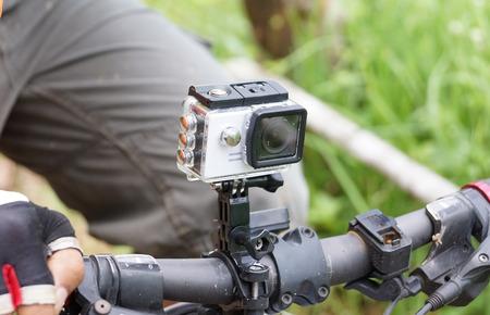 Digital camera installed on a handlebar of a mountain bike Banco de Imagens - 78151317