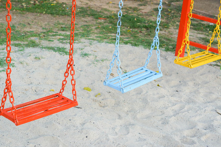 Swing in a playground for kids Stock Photo