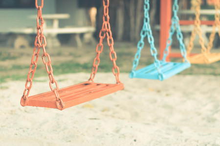 chain swing ride: Swing in a playground for kids Stock Photo