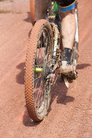 Derailleur of a mountain bike stuck with mud and grass  Cycling in wet condition concept