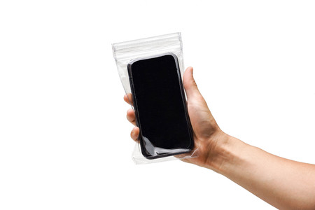 Hand holding a black smartphone with in a waterproof case Stock Photo