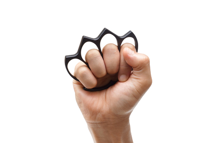 Male hand wearing a black knuckle isolated