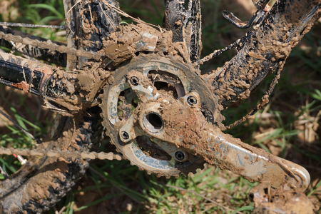 Dirty mountain bike covered with mud and dirt  Cycling in muddy and wet condition concept Stock Photo