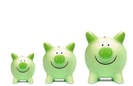 csr: Three green piggy banks in different sizes  Green business and grown concept