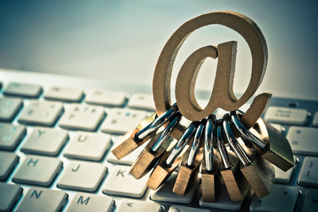Email sign with many padlocks on computer keyboard  Email encryption security and countermeasure concept