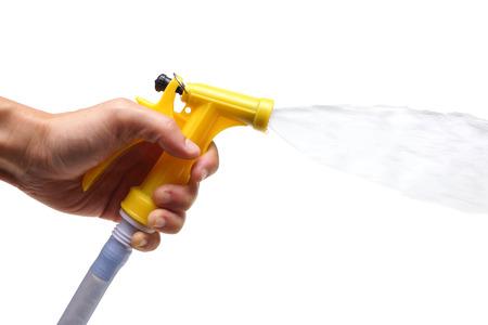 Wassersprühpistole für die Bewässerung von Pflanzen isoliert