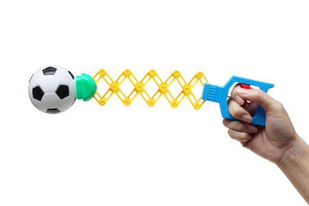 Toy - Hand playing with a ball puncher