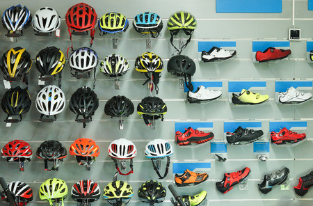 Bicycle helmets and shoes on shelves