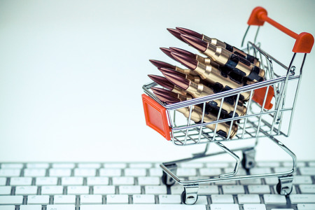 Rifle bullets on a shopping cart  Illegal weapon sold online in underground market concept
